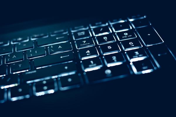 Closeup of laptop keyboard illumination, backlit keyboard